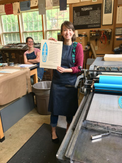 Gabby Rente '20 working on a broadside in the Lit House print shop.