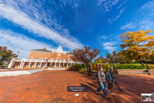 Screenshot of virtual tour. Photo shows students walking through Martha Washington Square.
